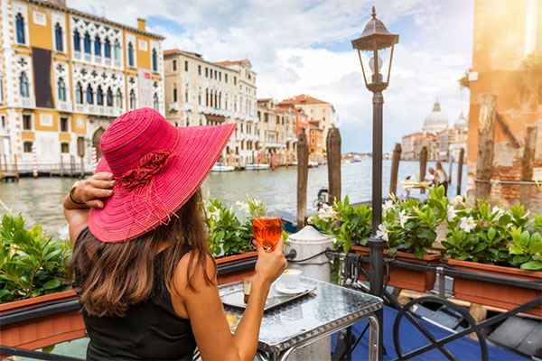enjoying a cocktail in Venice, Italy